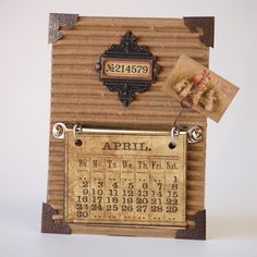 NL Tim Holtz Calendar ...  You can also incorporate pictures of each months memorable moments in one like this!  Past, present or future Christmas gifts!