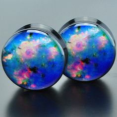 Black acrylic plugs with a picture of the Peony Nebula. Quantity: Sold as 1 pair (2 pieces) Style: round cut plug, 1 side flat 1 side convex, screw fit back Flare: Double flare Wearable Width: 6mm Siz
