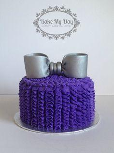 purple buttercream ruffle cake with silver fondant bow
