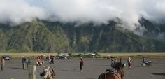 Clouds hanging over mountains, amazing sceneries,a sand sea, ponies, energizing cold weather , tourists and local people all make a perfect combination to create that incredible atmosphere that is Mount Bromo. Photo by Andika Saputra - www.indonesia.travel