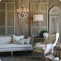 Old shutters create a relaxed elegant back drop in this room...
