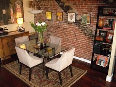 Eclectic dining room design with brick wall