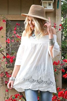 The ultimate combo of sexy and boho, this white top is designed with an oversized fit and billowy sleeves. Finished with a flirty lace & eyelet detailing along the hem, this top is perfect for complet What's Your temperature?