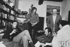 """Clifford Irving, his wife Edith, artist Elmyr de Hory (seated, R, in sports jacket), Gerry Albertini and Bob Kirsh.  Clifford Michael Irving (born November 5, 1930)   Note@ Clifford Irving is an American investigative reporter and author of best-selling novels and works of nonfiction, but best known for his hoax """"autobiography"""" of reclusive and eccentric businessman Howard Hughes in the early 1970s."""
