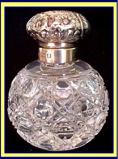 Antique Cut Glass Perfume Bottle With Sterling Silver Top.....