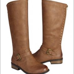 Light brown studded buckle riding boots! Cute light brown riding boots from Justice!Studded details along the back zipper, with red trim and buckle detail. Size 9. These boots were loved, but still have wear left. Creasing from wear as the 3rd and 4th pictures indicate, but are in overall good condition! Justice Shoes