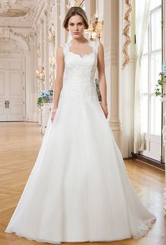 """Brides: Lillian West. Organza, scalloped corded hem lace ball gown with a Queen Anne neckline. Buttons to end of train, organza covered buttons, 136"""" circular cut lace veil, layered corded scalloped hem lace."""