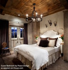Barnyard decor -- we're loving raw wood and shades of brown. Old wooden floors, beams and stone features provide a charming backdrop for almost every type of personal décor. #charlesprogers #barns  #beds