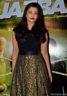 Aishwarya Rai Bachchan wearing a top and tea length skirt by Theia Couture. via Voompla.com