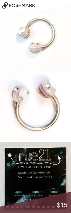 NWOT Swarovski Crystal 14 Gauge Body Jewelry NWOT Swarovski Crystal 14 Gauge Body Jewelry. Horse shoe style with beautiful Swarovski crystals and pale marbled balls. Stainless steel. Can be used for belly , septum, eyebrow, etc. Rue 21 Jewelry