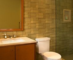 Stunning Variegated Pattern Wall Tiling Features White Elongated Small Bathroom