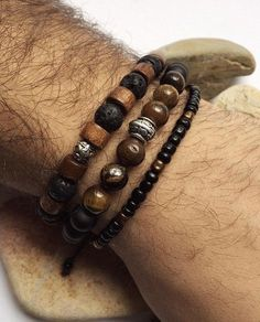 Natural look men bracelet set, brown wooden beads, tiger eye, black onyx, lava natural stone beads bracelets and seed from EchoHandmadeDesign on Etsy.