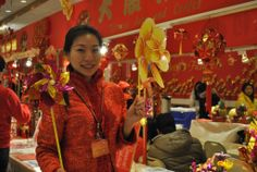 A volunteer greets visitors at the Fo Guang Shan Buddhist Temple Lunar New Year fair Buddhist Temple, Lunar New, Chinese New Year, Toronto, Canada, Leather Jacket, Asian, Celebrities, Studded Leather Jacket
