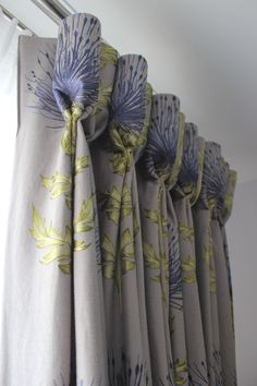 Mostly solid fabric with edged floral print in a goblet pleat drapery panel