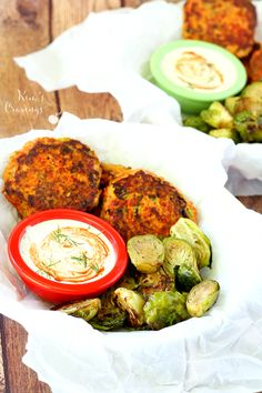 Sweet Potato Salmon Cakes with Creamy Dill Sriracha Sauce- creamy sweet potato binds with flaky pan-seared salmon in this uber-healthy super food combo.
