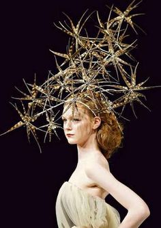 from the studio of milliner Richard Nylon Can't say I'd wear it, but it's certainly very editorial.
