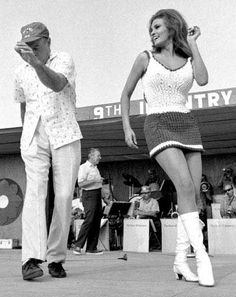 Bob Hope dancing and singing with Rachelle Welch on USO tour - 1960's