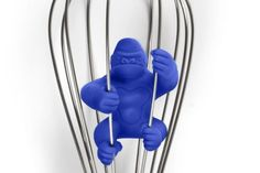 Plastic silicone gorilla monkey figure that looks like King Kong inside a whisk