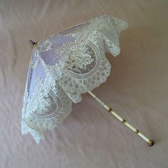 France by Verdier This type of parasol is designed with a folding handle to be more compact when not in use. The handle has a second. Purple Umbrella, Lace Umbrella, Lace Parasol, Vintage Umbrella, Under My Umbrella, Antique Lace, Vintage Lace, Cantilever Parasol, Umbrellas Parasols