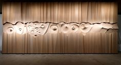 "Created by Tapio Wirkkala, this wood wall sculpture titled ""Ultima Thule"" was exhibited at Expo 67 in the Scandinavian pavilion. It's 30' by 14' and consists of 100 layers of birch veneer that was hand carved into relief inspired by how nature erodes and sculpts the landscape. It's now a part of the permanent collection of the Espoon Museum of Modern Art."