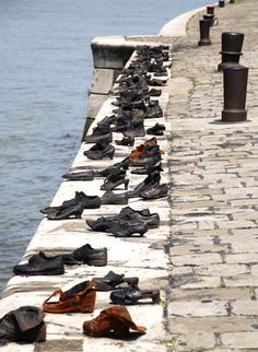 Budapest, HUNGARY: Toward the end of World War II, as the remaining Jewish population awaited death by gunfire, they discarded their shoes which still remain on the bridge facing the Buda Castle. Places Around The World, Travel Around The World, Around The Worlds, Bratislava, Danube River Cruise, Buda Castle, Hungary Travel, Budapest Travel, Central Europe