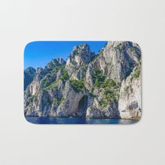 The perfect Bath Mats: fuzzy, foamy and finely enhanced with brilliant art. Featuring a soft, quick-dry microfiber surface, memory foam cushion and skid-proof backing. - Available in two sizes - Soft, fuzzy microfiber surface - Memory foam cushioning - Skid-proof backing #capri #italy #grotto #art #decor #landcape #photography #bath #bathroom #rug #bathmat