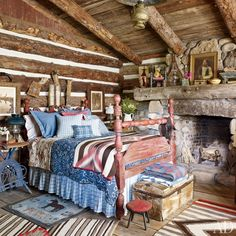 Ralph Lauren's COLORADO GUEST CABIN BEDROOM Ralph Lauren Home linens mix with antique and vintage bedding on the cabin's 1870s cannonball bed; a circa-1900 hooked rug and two '20s Navajo rugs are on the floor.