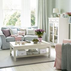 This is super pretty!! Beautiful pastel living area, love the sky blue couch!