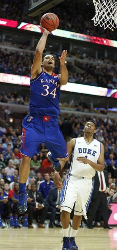 Kansas forward Perry Ellis floats for a shot against Duke forward Jabari Parker during the second half of the Champions Classic matchup on Tuesday, Nov. 12, 2013 at the United Center in Chicago. #KU
