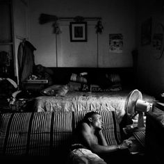 Bongani playing solitaire, Brakpan, South Africa, 2012. By Marc Shoul.
