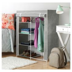 Organize any room fast with Whitmor's Compact Clothes Closet. Easy no-tool assembly helps this freestanding unit come together fast, and it's compact design makes it perfect for smaller spaces. The unit features a garment rod, plus 5 fabric shelves perfect for storing hanging items alongside folded garments. The unit also features a cover that folds sdown to further protoect your stored garments.