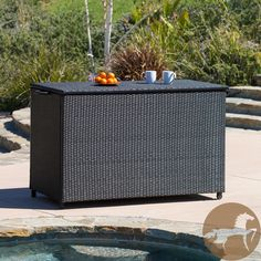 Protect, organize, and store all your outdoor pillows, pool toys, and deck supplies with this gorgeous outdoor cushion storage box that features a wicker finish. Convenient wheels and side handles allow you to move this piece around your yard with ease.