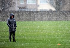 Kenny Dalglish oversees a Melwood training session as the snow pours