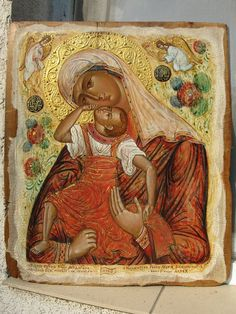 The Panagia Pelagonitissa icon is a variant of the Panagia Glykophilousa, with Christ in an embrace with his mother, and his back turned .
