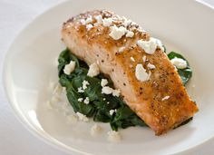 Broiled Salmon with Spinach, Feta, and Lemon - 4 (6-ounce) skinless salmon fillets 1 tablespoon olive oil 4 cups firmly packed baby spinach ¼ teaspoon lemon zest 1 teaspoons lemon juice ½ cup crumbled feta salt and pepper to taste