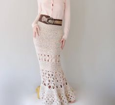 Check out thisgorgeous crochet maxi skirt! Use wool yarn for a fall/winter weight garment and cotton for spring/summer! Pattern includes Detailed Instructions In English and crochet charts for all parts of the skirt.