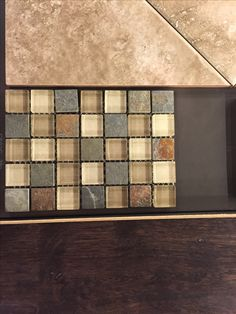 BEAUTIFUL multicolored transition tiles. These are shown next to a great sand colored ceramic and Manchester Coffee Wide Plank Hardwoods. Perfect for kitchen to living room or even for bathrooms to bedrooms or hallway transitions.