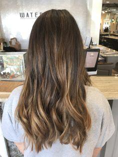 Subtle balayage on brunette hair.  Sun kissed, caramel tones