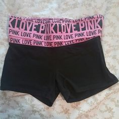 VS Pink yoga shorts practically new! Victoria's Secret PINK yoga shorts with fold over elastic band with lettering on it - no cracking or stretching on this print at all, they look brand new. Really adorable and perfect for the gym or working out. Size XS. I bought them off here and never wore them, doesn't look like the previous owner ever wore them either so they could be NWOT! Make an offer!  workout VS Pink yoga pants leggings nwt cute girly PINK Victoria's Secret Shorts