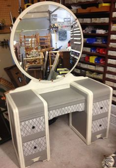 What a great paint job given to this vintage vanity.   So always remember to look at the bones of furniture.  The outer look can always be changed by refinishing given a new paint job or stain it another color.  Mod Podge is also an option.