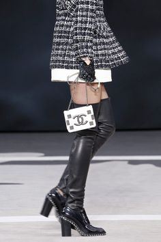 """FALL 2013 READY-TO-WEAR Chanel / """"I've got my feet on the ground, but this collection is up-to-earth, not down-to-earth."""" While he was speaking, Karl Lagerfeld was strategically placed under the massive globe that majestically revolved, center stage, during the Chanel presentation. So the only way to earth was, in fact, up. But, figuratively speaking, the collection he showed was also """"up"""": one of those confident, energetic, clothes-packed epics that he could probably draw in his sleep."""