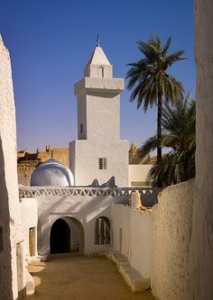 Acla- Old Town Entry, streets of Ghadames, very old UNESCO World Heritage town in Libyan desert. Ghadames has a harsh climate, but architectural & settlement pattern were designed to protect against summer heat & cold winters. Houses were built with thick walls of local mud brick, limestone, palm wood & lime to retain heat during winter & keep interior cool in the summer. ~ by Eric Lafforgue
