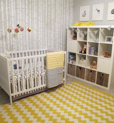 Woodland-themed nursery with yellow accents