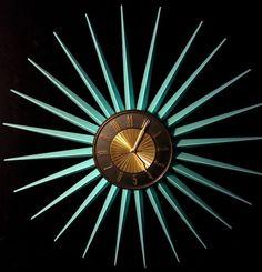 Aqua-turquoise starburst clock.