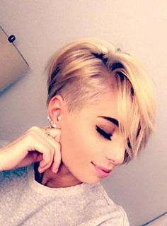 Love this pixie cut with soft lines but a little shave too.