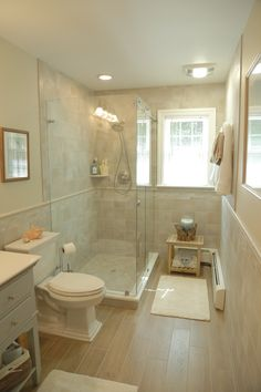 walk in shower plank flooring. nice colored bathroom