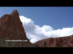 Time lapse clouds float behind a red rock formation.     Purchase this clip from A Luna Blue:   http://www.alunablue.com/america-stock-footage/south-west/south-west-02/clip-07.html     A Luna Blue Stock Video.   Imagery for Your Imagination.   http://www.alunablue.com