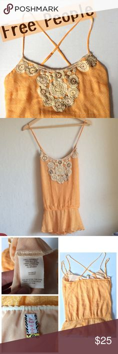 Free People Chiffon Crochet Crisscross Back Tank ACCEPTING OFFERS!!. No low ballers. No trades. Used but excellent condition. Cute with leggings/shorts/jeans and sandals or flats. Orangey peach color. Crochet detail. Crisscross straps. Retail $70 Free People Tops Tank Tops
