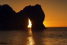 Durdle Door Sunrise by Peter Spencer on Sunrise, Doors, Celestial, Explore, Photography, Outdoor, Image, Light And Shadow, Shades