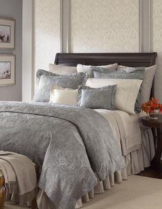 Love the mix of grey and taupe bedding with the dark wood furniture... so soft and sophisticated.